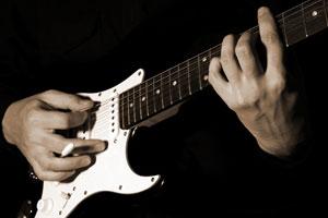 como tocar la guitarra electrica